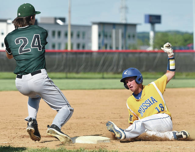 Russia's Zane Shappie slides safely into third as Lancaster Fisher Catholic's Josh Burke fields the ball during a Division IV regional semifinal on Friday at Cincinnati Princeton High School.