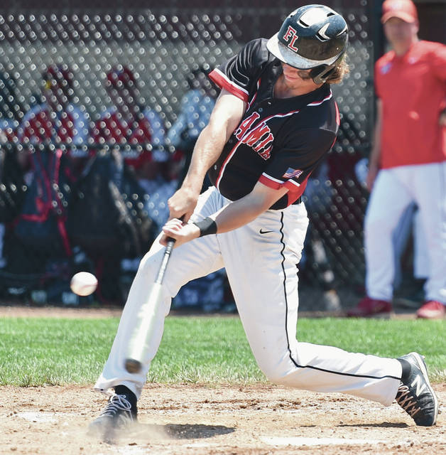 Fort Loramie's Grant Albers swings during a Division IV regional semifinal against Cedarville on Friday at Cincinnati Princeton High School. The Redskins will face Warren John F. Kennedy in a Div. IV state semifinal on Saturday in Akron.