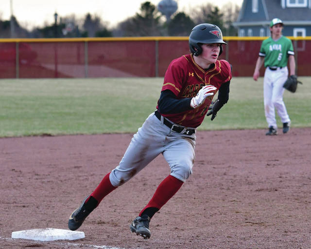 New Bremen's Mitchell Hayes rounds third base on his way home against Anna.