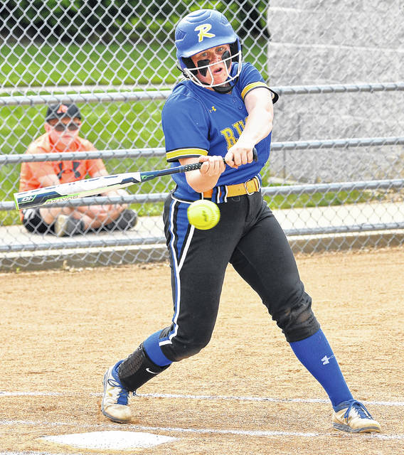 Russia junior catcher Riley Hammonds swings at a pitch during a Division IV district final softball game against Ansonia on May 21 in Versailles.