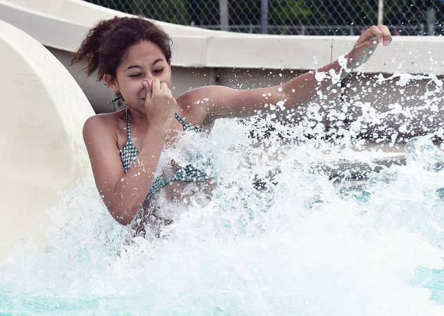 Alana Grant, 13, of Sidney, daughter of Sabrina Murphy, comes flying out of a waterslide at the Sidney City Swimming Pool on Sunday, June 6. It was opening weekend for the pool.