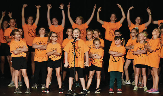 """Adalyn Barger, center, 9, of Sidney, performs the part of the """"lead pitcher"""" during the musical """"It's A Hit!"""" at the Historic Sidney Theatre on Saturday, June 26. Adalyn is the daughter of Deb Phelps and Mark Barger."""