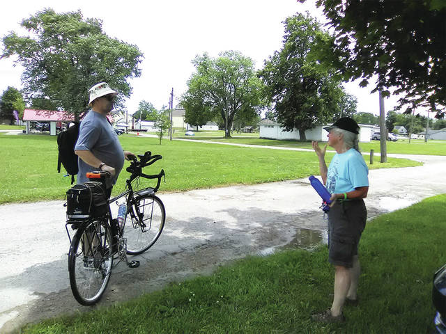 Matthew Zigler, left, of Columbus, talks about his plans for the day with Nancy Vallen, right, of Ashtabula. Zigler and Vallen are two of over 250 participants in the Western Ohio Bicycle Adventure, a week-long cycling tour that began Saturday in Sidney.