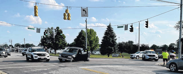 Sidney Police respond to a crash involving a black Ford F150 truck, driven by Madison Wendel, 24, of Sidney and a Honda Gold Wing motorcycle (not pictured) at the intersection of Russell Road at Wapakoneta Avenue Saturday evening, June 12. The rider of the motorcycle, Noah Collins, 20, of Sidney, was initially transported to Wilson Health and then later taken by CareFlight to Miami Valley Hospital for his injuries.