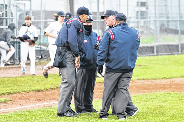 The 2021 Ohio High School Athletic Association Division I state championship baseball umpiring crew gets a game in prior to heading to state.