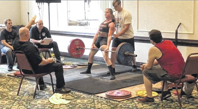 Cheritha Miller, of Sidney, pulls 363 pounds in her last powerlifting competition held at The City Center in Toledo in July 2018. She took first place and set a state record for the dead lift. She was a member of the WADFPF Federation. Miller is vying to win the cover of Muscle & Fitness HERS Magazine. Voting for the first round to make the top 15 ends June 24.