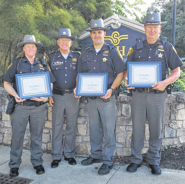 Pictured are Deputy Lynn Marsee, left to right, Sheriff James R. Frye, Deputy Matt Luthman and Deputy Dave Egbert. Frye presented the deputies with the Buckeye State Sheriff's Association (BSSA) life-saving awards and ribbons.