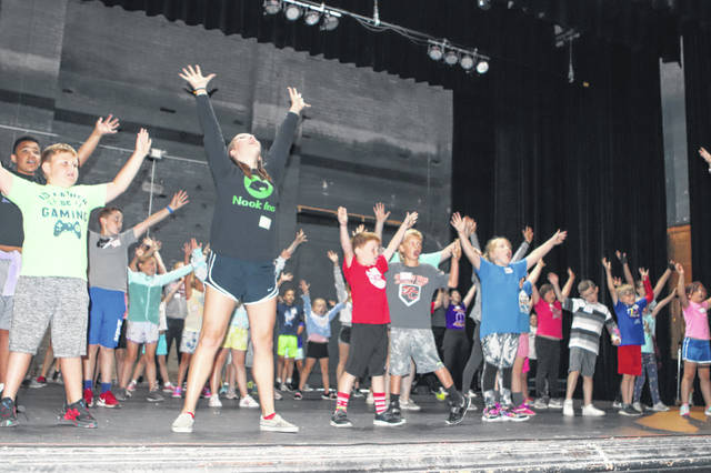"""First through fourth-grade students practice """"It's a Hit"""" Tuesday at the Sidney Historic Theatre's summer camp. The students will perfom the play Friday at 7 p.m."""
