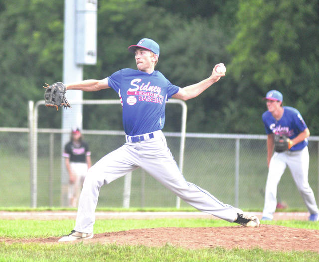 Sidney Post 217 Red's Eric Schmidt throws a strike during an American Legion baseball game on Tuesday at Duke Park in Troy. The Legion squad began its season last week. Sidney Post 217 is operating two senior squads this year, a Red squad and a White squad.