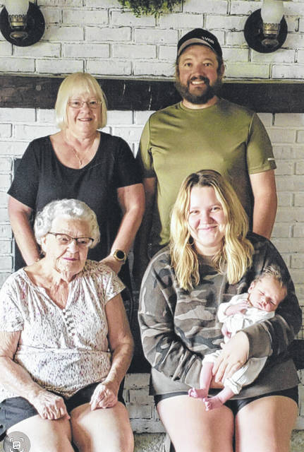 Katie Rodriguez, of Celina, holds her son, Jack, while sitting beside her great-grandmother, Belva Gross, of Sidney. Behind her is her father, Dusty Weitzel and her grandmother, Candy Weitzel Ford, both of Celina.