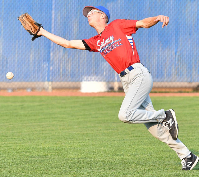 Sidney Post 217 White's Ryan Caufield goes for a pop up in shallow right field during the eighth inning of an Ohio American Legion state tournament game on Wednesday at Beavers Field in Lancaster. Caufield missed the catch, which allowed Napoleon Post 300 to score the winning run and eliminate Sidney with a 10-9 win.