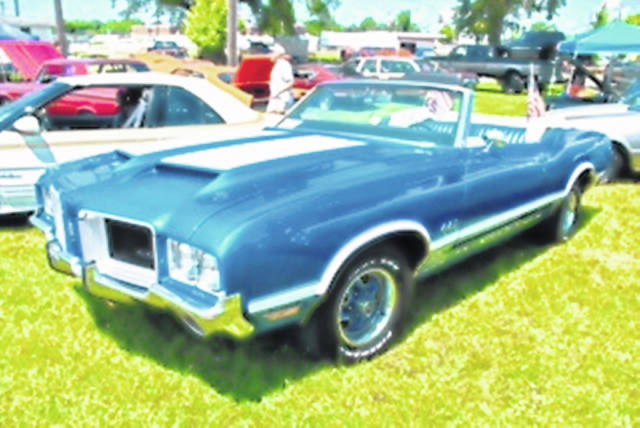 The Shelby County Fair Car Show welcomed 65 registered cars and several non registered cars during the show Sunday, July 25. People were asked to vote for their favorite car. Top 10 awards were given to Emerson Van Horn, 58 Nash; Mark Schroer, 57 Chevy; Joe Wacker, 69 Cameron; Steve Johnson, 70 Mustang; Diane Schroer, 31 Chevy; Craig Ballweg, 59 Pontiac; Fred Tatum, 62 Convertible; Robin Applegate, 68 Mustang; California Rowland, 52 Chevy Truck; and Jerry Barga, 65 Belvedere. The Dale Anderson Family Trophy went to Bob Leonard's 71 Cutlass Convertible, pictured here.Kurt Anderson, Car Show organizer, shared is was a great turn out when you consider the hot weather.