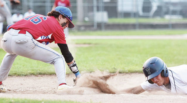 Sidney Post 217 Red's Gavin Roberts attempts to pick off Greenville Post 140's Ben Ruhenkamp at first base during an Ohio American Legion tournament game on Wednesday at Sater Park in Greenville.