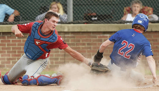 Sidney Post 217 Red's Carson Regula tries to tag Post 217 White's Ryan Schloss at home plate during the Ohio American Legion Region 2 championship game on Thursday at Sater Park in Greenville.