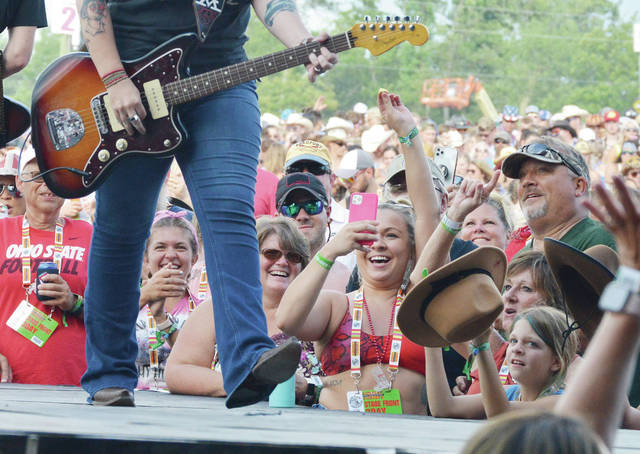 Fans react to Ashley McBryde performing in front of them at Country Concert on Thursday, July 8.