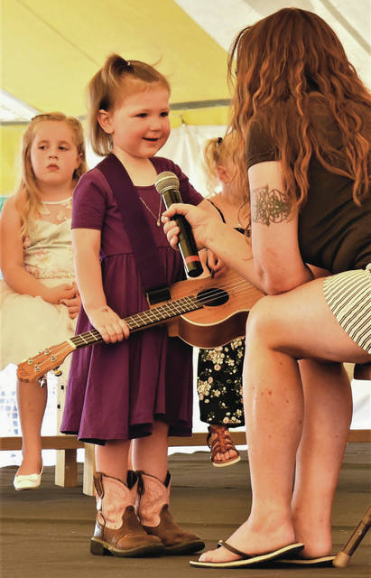 Hannah Bensman, 3, of Anna, is interviewed for the title 0f Little Miss of the 2021 Shelby Co Fair on Sunday, July 25. Hannah is the daughter of James and Toni Bensman.