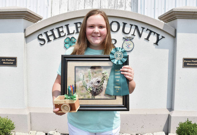 Successful 4-H Club member Amanda Roush, 12, of rural Sidney, daughter of Karen and Darrin Ike, and Rodney Roush, won first place nature photo at the Shelby County Fair.
