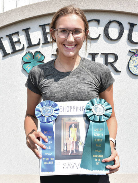 Russia Fashionetts member Eliza Gariety, 16, of Russia, daughter of Greg and Connie Gariety, won outstanding of the day and state fair participant for shopping savvy - senior at the Shelby County Fair.
