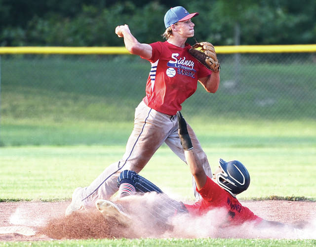 Sidney Post 217 Red's Evan Eilerman throws towards first after forcing Piqua Post 184's Desmond Warner out at second during an American Legion baseball game on Tuesday at Custenborder Field.