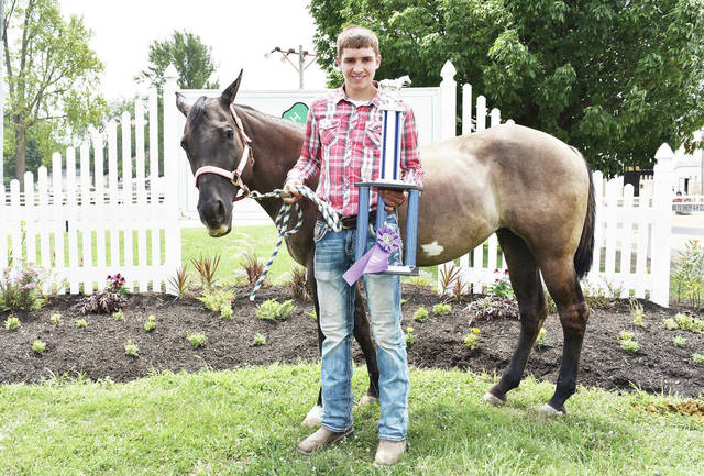 Happy Trails member Camdyn Reese, 17, of Jackson Center, son of Jamie and Becky Reese, won reining grand champion at the Shelby County Fair.