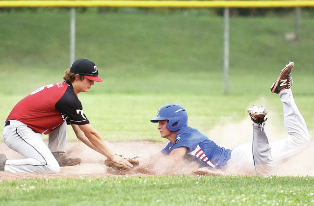 Sidney Post 217 Red's Carson Regula slides into second as Troy Legends' Tucker Miller attempts to tag him during an American Legion baseball game on Wednesday at Custenborder Field.