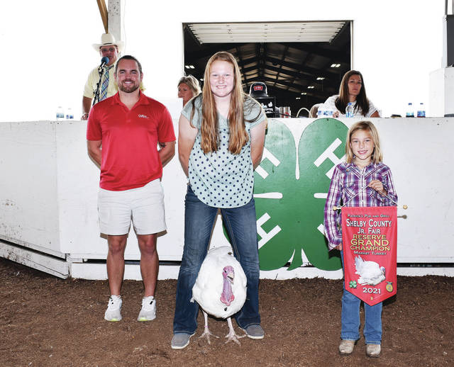 Anna Livestock member Mallory Havenar, 15, of Sidney, daughter of Amy and Britt Havenar, sells her reserve grand champion market turkey at the Shelby County Fair on Friday, July 30. Buying the turkey are Botkins Family & Jackson Ctr Dental, Brandt Farms, Goffena Furniture Inc, Shelby Co Ag Educators, Kevin & Jenni Shoffner and Judge Jeff Beigel.