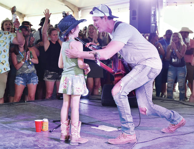 Grace Schander, left, 6, of Hulmeville, had the chance to take the stage with singer Clark Manson for a song on the Dr Pepper VIP stage at Country Concert 2021 on Saturday, July 10. Schander is the daughter of Henry and Jessica Schander.