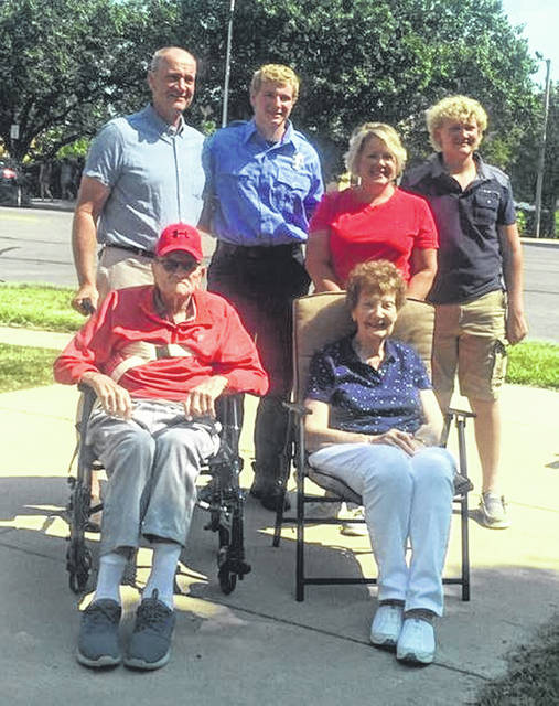 Sidney Department of Fire & Emergency Service's newest firefighter, Henry Ruhenkamp, back row second from left, with his father, mother and brother, Greg, Jenny and Will Ruhenkamp, by his side and grandparents Don and Pat Ruhenkamp, seated in front of him after was sworn-in out front of Sidney Fire Station 1 on Poplar Street on Monday, July 26. Henry Ruhenkamp's father and grandfather, Greg and Don, are former volunteer firefighters with the Fort Loramie Fire Department.