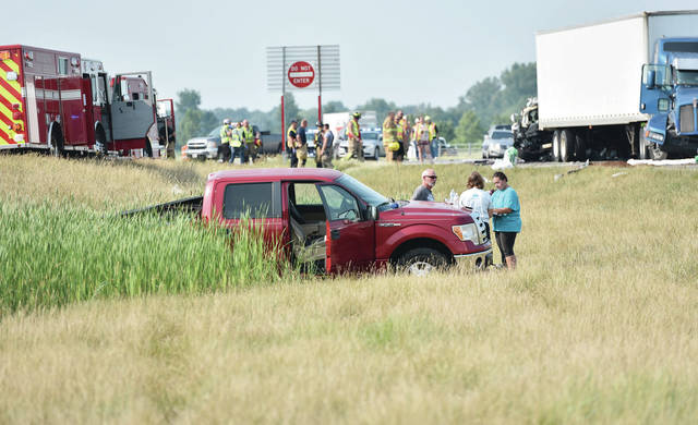 A pickup truck sits in between I-75 and the southbound Botkins off ramp after a multi vehicle crash on Monday, July 5.