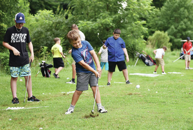 Owen Wilt, front, 8, of Anna, son of Sandy and Ashley Wilt, takes part in Jr. Golf Week held by the Moose Golf Course on Tuesday, July 13. The 5 day program is run by PGA Professional Ashley Wilt who said this is the third year running the event. He said they had 12 kids sign up the first year and 90 kids this year.