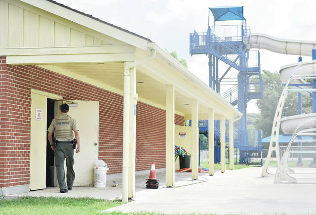 A city of Sidney park ranger enters a utility building at the Sidney water park on Wednesday, July 14. The filter building at the Sidney Water Park was vandalized during the previous night, causing the city to close the municipal pool Wednesday and possibly on Thursday.