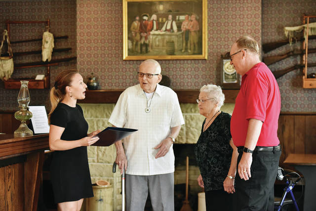 Ohio State Rep. Susan Manchester, left to right, presents a commendation certificate to Fort Loramie Historical Association Charter Members Tom and Janet Busse and Fort Loramie Historical Association President Jim Rosengarten, all of Fort Loramie, at the Wilderness Trail Museum in Fort Loramie on Friday, July 23.