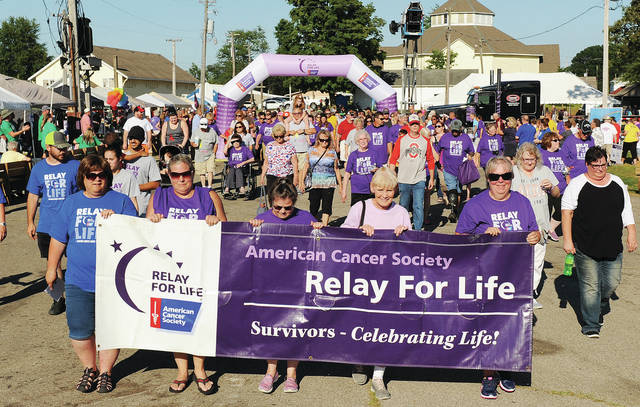 The surviviors lap gets going at the start of the 2019 Shelby County Relay for Life at the Shelby County Fairgrounds.
