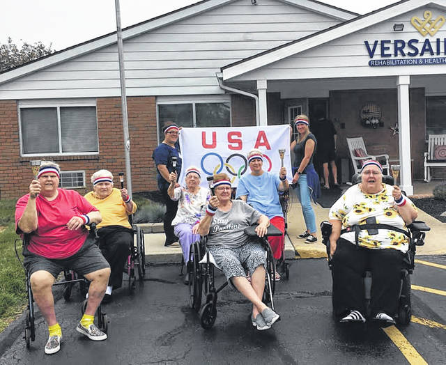 The Gorgeous Grandmas group held a torch lighting on July 23, the same day the Olympics began, at Versailles Rehabilitation and Healthcare Center.