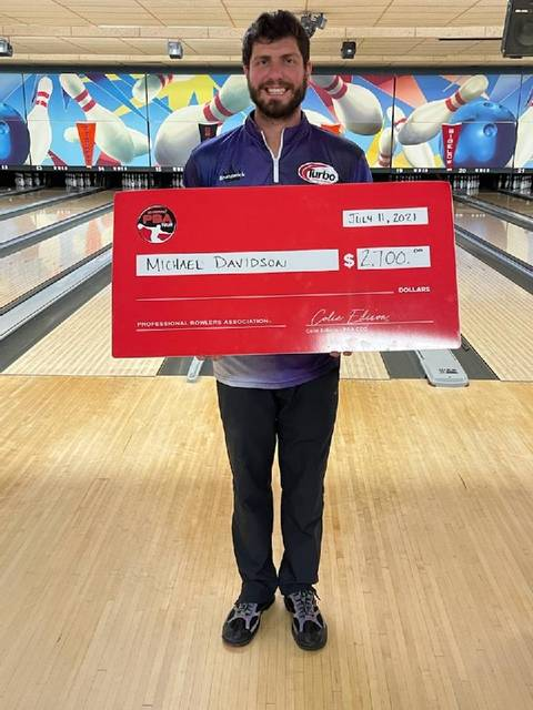 Versailles resident Michael Davidson poses after winning a PBA event recently in Columbus. Davidson will compete in PBA events in Minster and Coldwater in August.
