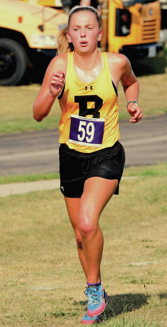 Botkins' Brittany Arnold runs during the Shelby County Preview cross country meet's girls race on Tuesday at Sidney High School. Arnold finished first in 12:35. The race was shortened to two miles due to hot temperatures.
