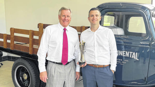 Russ Gottemoeller, owner of Continental Express, left, and Grant Mitchell, Continental Express director of customer relations, are pictured with the 2020 Abbott Truckload Carrier of the Year award.