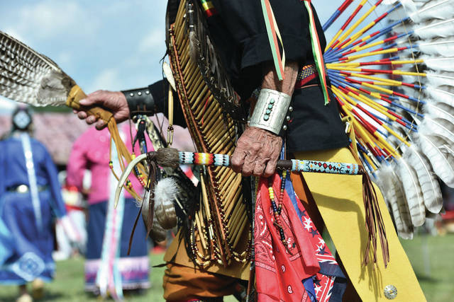 Paul Jones, of Bath, Ind., carries a Lakota style dance stick in his left hand as he dances during the 10th annual Honoring Our Veterans and First Responders Pow Wow on Saturday, Aug. 21, at the Shelby County Fairgrounds.