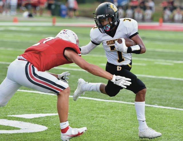 Sidney freshman receiver Julius Spradling runs past Tippecanoe's Griffin Caldwell during a Miami Valley League crossover game on Friday in Tipp City. Spradiling scored the Yellow Jackets' lone touchdown.