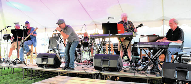 The Ohio Mystery Band performs at the 2021 McCartyville Parish Picnic on Saturday, Aug. 14.