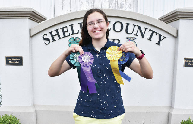 Houston Livestock 4-H Club member Kierstyn Oberdorf, 18, of Sidney, daughter of Christina and Brian Helman, and Larry Oberdorf Jr., won state fair qualifier, second place nature photo, best of class - focus on photography, top 10 and outstanding of the day.