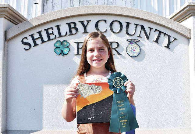 McCartyville Producers 4-H Club member Emma Wuebker, 9, of Anna, daughter of Craig and Heather Wuebker, won Outstanding of the Day 20C: paintings, junior at the Shelby County Fair.