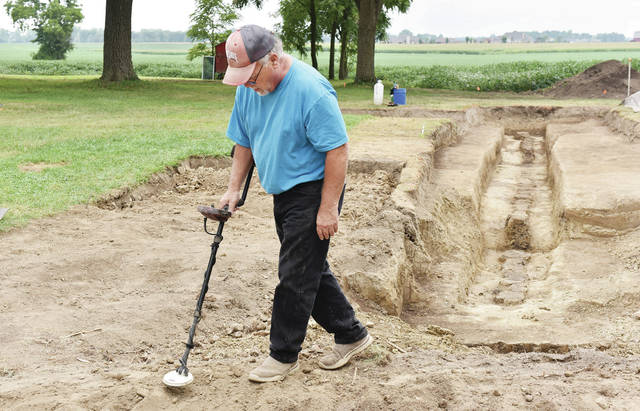 On Monday, Aug. 16 Wayne's Legion Research Group member WB Baughman, of West Liberty, uses a metal detector to try and find objects next to what was once the north stockade wall of Fort Loramie. The remains of the wall were found by Greg Shipley recently. Shipley has been searching for the fort for 8 years around the Fleckenstein farm house and nearby farm land just north of Fort Loramie off of State Route 66.