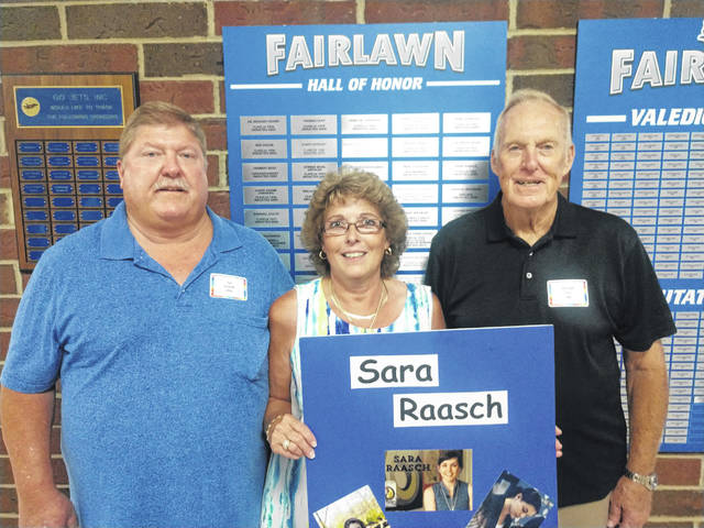 Fairlawn Local School Distict held its annual Hall of Honor ceremony Saturday, Aug. 28. Welcomed into the Hall of Honor were, left to right, Tim and Jackie Everett and Michael Fair. They are holding a poster of Sara Raash, who was unable to attend.