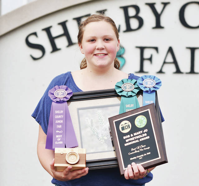 Successful member Amanda Roush, 12, of rural Sidney, daughter of Karen and Darrin Ike, won best of class in controlling the image, Bob and Mary Jo McReynolds Memorial Award, state fair qualifier, outstanding of the day and first place nature photo.