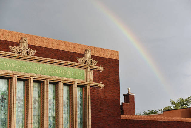 A rainbow arches over The Peoples Federal Savings and Loan building after a brief lightening storm came through Sidney on Thursday, Aug. 12.