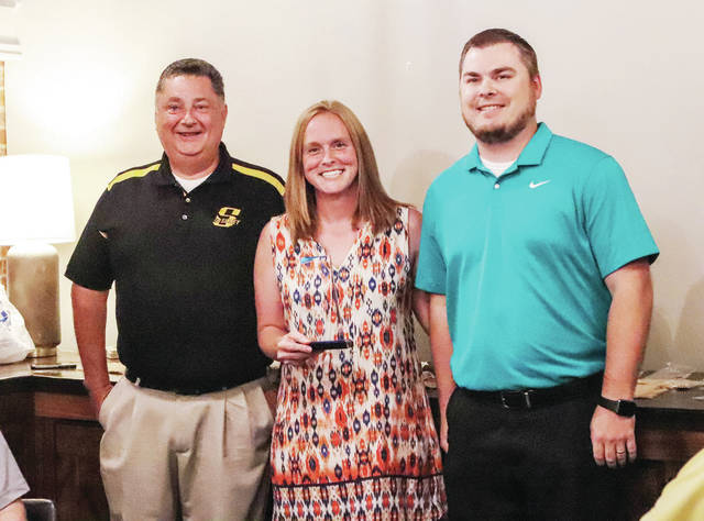 Sidney High School Intervention Specialist Mandy Gutman, center, is recognized by Sidney City Schools Superintendent Bob Humble, left, and Sidney High School Principal Greg Snider during a Rotary meeting in Murphy's on Monday, Aug. 16.