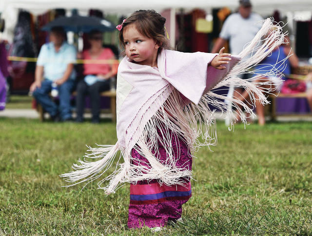 Althea Reiter, 2, of Cincinnati, dances in the 10th annual Honoring Our Veterans and First Responders Pow Wow on Sunday, Aug. 22, at the Shelby County Fairgrounds. Althea is the daughter of Juan Reiter and Sarah Clark.