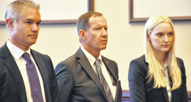 Wapakoneta Mayor Thomas Stinebaugh is flanked by his attorneys, David Thomas and Kathryn Wallrabsenstein, during his arraignment hearing Tuesday in Auglaize County Common Pleas Court.