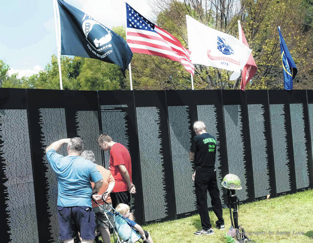 Area residents visit the AVTT-TWF Traveling Wall during its last exhibit in Sidney in 2015. The Shelby County Historical Society will bring the wall to Sidney again as part of a week of events, Sept. 12-19.